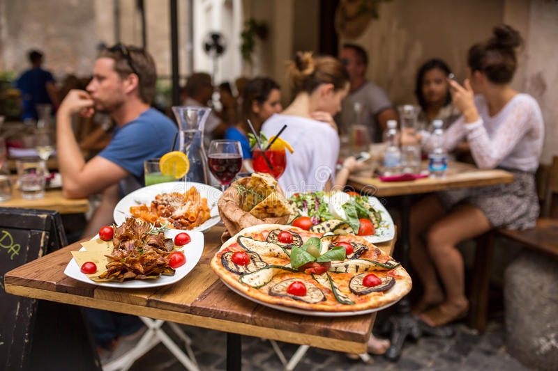 unidentified-people-eating-traditional-italian-food-outdoor-restaurant-rome-italy-september-trastevere-district-rome-61947191